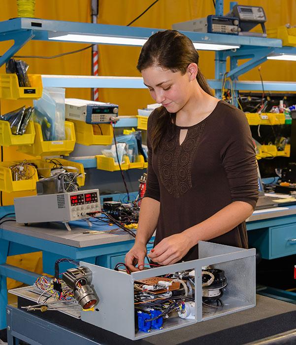Engineer working on electronics